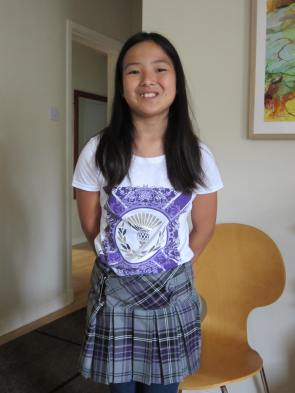 Abbie in her very own kilt, complete with thistle tee, symbol of Scotland