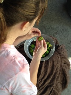 Erin adding cloves to peppers